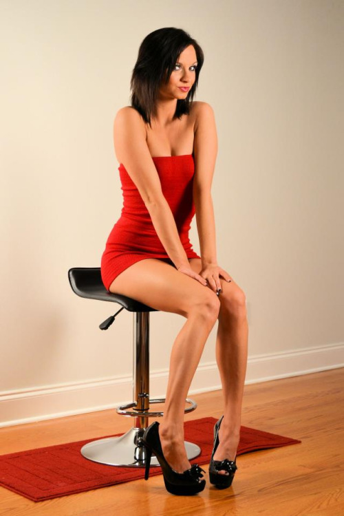 Ashley Sinclair In A Miniature Red Dress And Black